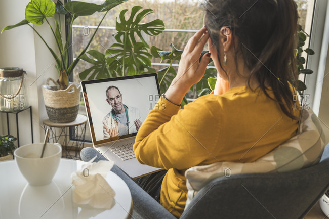 Woman consulting with doctor during video call on laptop