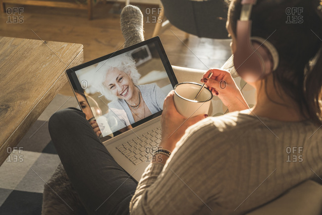 Senior woman smiling on laptop screen during video call