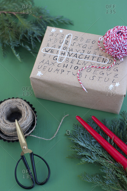 Scissors- string and word search puzzle on wrapped Christmas present