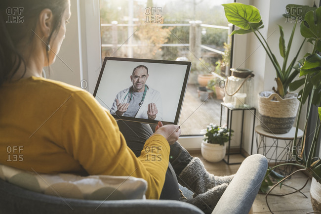 Woman consulting with doctor during video call on digital tablet