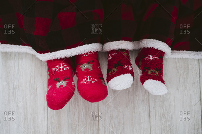Man and woman wearing Christmas sock at home during Christmas