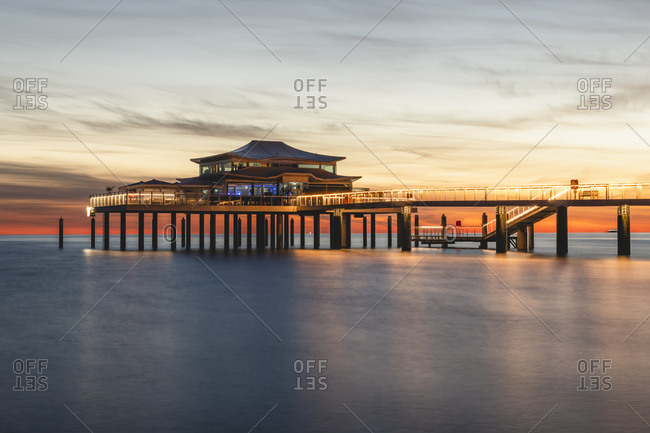 Germany- Schleswig-Holstein- Timmendorfer Strand- Teahouse at end of coastal pier at dawn