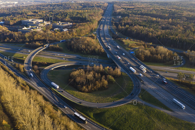 Germany- Baden-Wurttemberg- Stuttgart- Aerial view of traffic on Bundesautobahn 8 at dusk