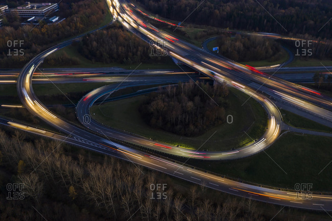 Germany- Baden-Wurttemberg- Stuttgart- Aerial view of vehicle light trails on Bundesautobahn 8 at dusk
