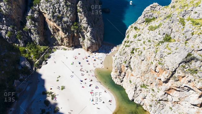 Drone shot of Mlljorca beach on sunny day- Torrent De Pareis- Sierra De Tramuntana- Balearic Islands- Spain