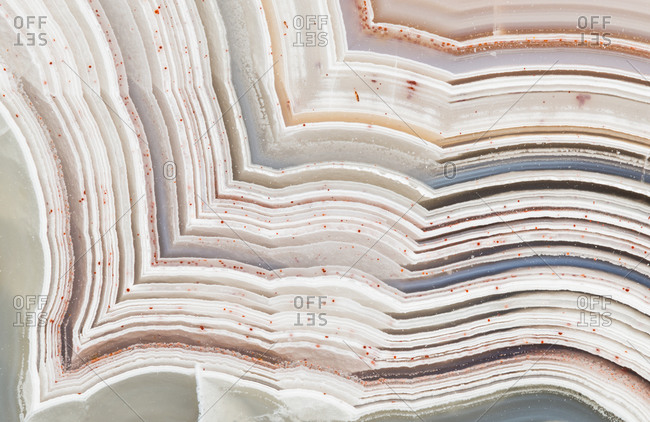 Extreme closeup of the banding patterns in a cut and polished Laguna lace agate from Mexico