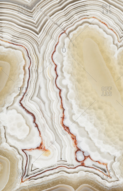 Macro photograph of the banding pattern in a laguna lace agate from Mexico