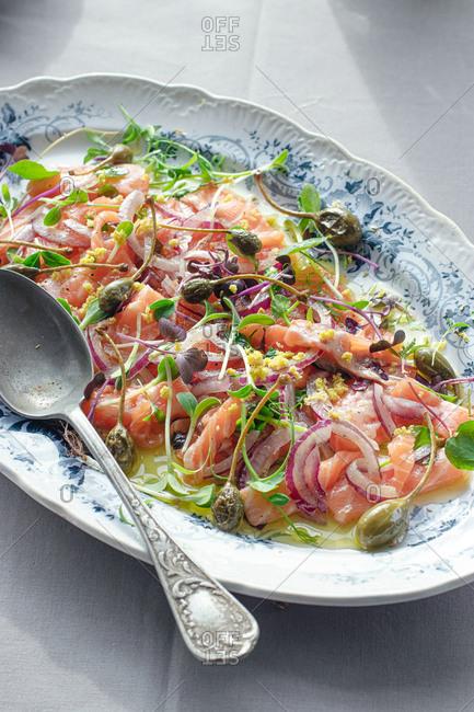 Tasty Salmon Sashimi Carpaccio Salad with Capers and Onion