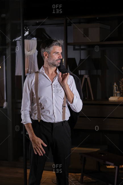 Stock photo of elegant middle aged man posing in his dressing room.
