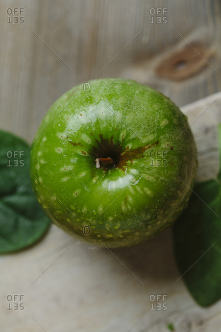 Top view of green apple on wooden table