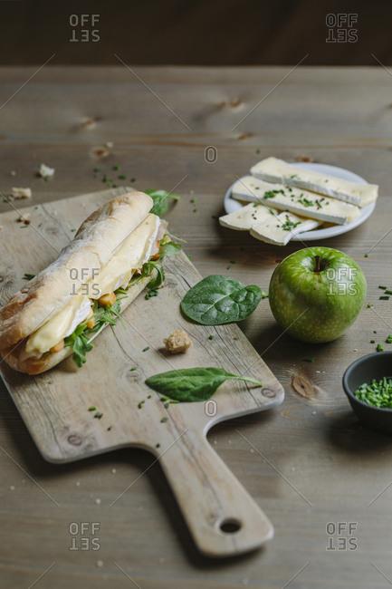 Healthy panini of cheese, arugula and apple
