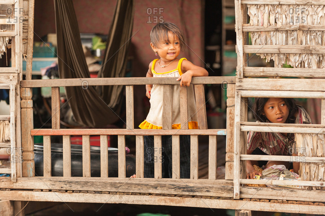 Floating Village, Kompong Chnang, Cambodia - 06 September 2009: Young Children Are Kept Safe In Floating House By Simple Hand Rails.