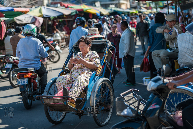 Cyclo Passenger, Phnom Penh, Cambodia - 30 October 2009: : Typical Cycle Rickshaw With Passenger In Market Area.