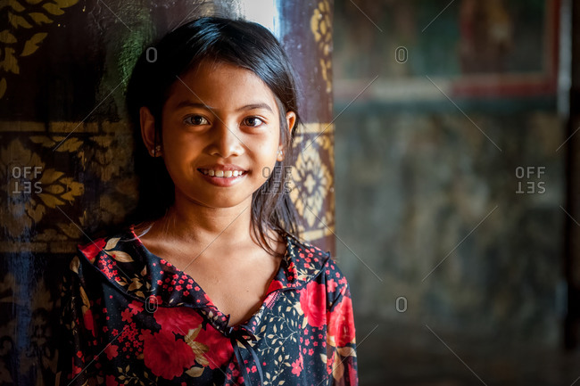 Portrait, Udong, Cambodia - 11 July 2010: Young Khmer Girl Against Pillar Inside Main Temple.