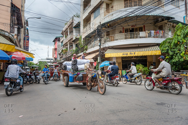 Typical Traffic, Phnom Penh, Cambodia - 24 July 2010: Charcoal Delivery On Busy Street In Riverside Quarter.