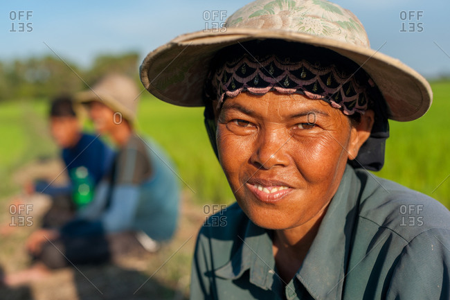 Kompong Chnang, Cambodia - 19 September 2010: Portrait Of Cambodian Women Working In Rice Paddy Field.