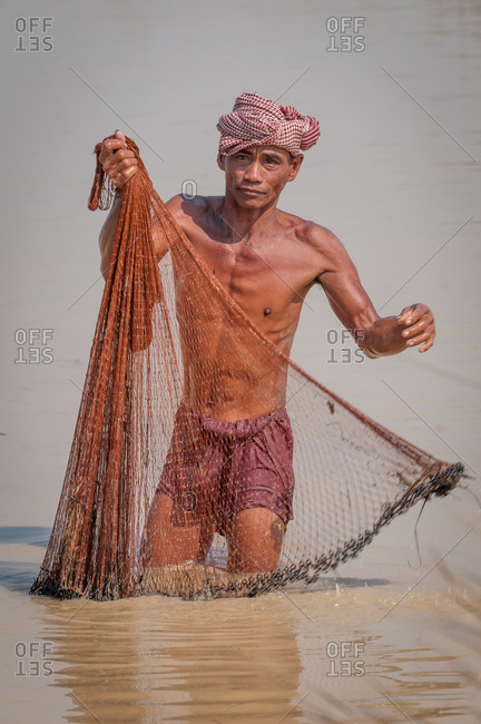 Preparing Fishing Net, Siem Reap Province, Cambodia - 21 January 2011: Local Khmer Fisherman Prepares His Traditional Net For Next Throw.