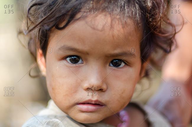 Kompong Chnang, Cambodia - 03 February 2011: Portrait Of Young Rural Cambodian Girl.