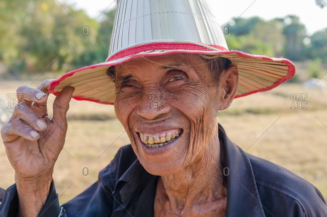 Kompong Chnang, Cambodia - 03 February 2011: Portrait Of Elderly Cambodian Farm Worker.