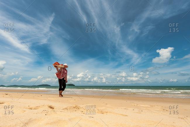 Sihanoukville, Cambodia - 24 May 2011. Freelance Khmer Sells Woman Walks The Beach Selling Fresh Lobster.