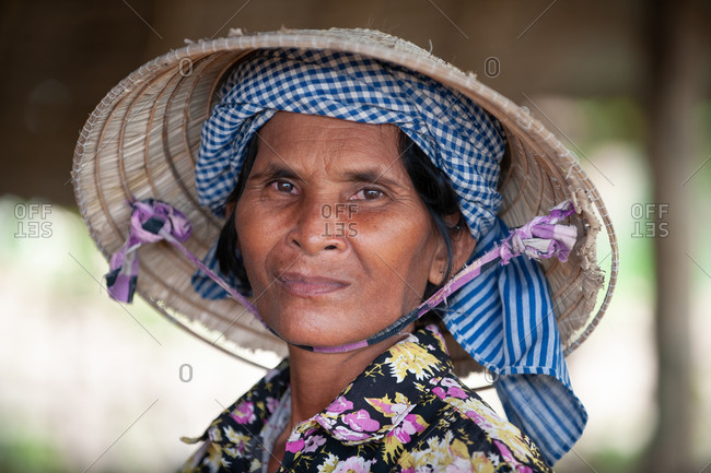 Portrait, Cambodia - 21 July 2011. Khmer Farmer Wearing Both A Typical Khmer Krama Scarf And A Conical Hat.