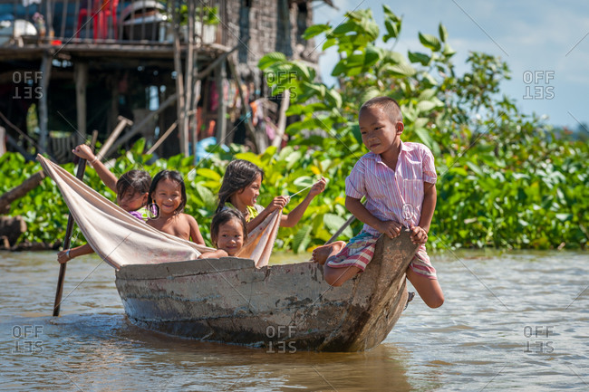 Floating Village, Kompong Chnang, Cambodia - 21 August 2011: Khmer Children Have Fun Playing In Boat,