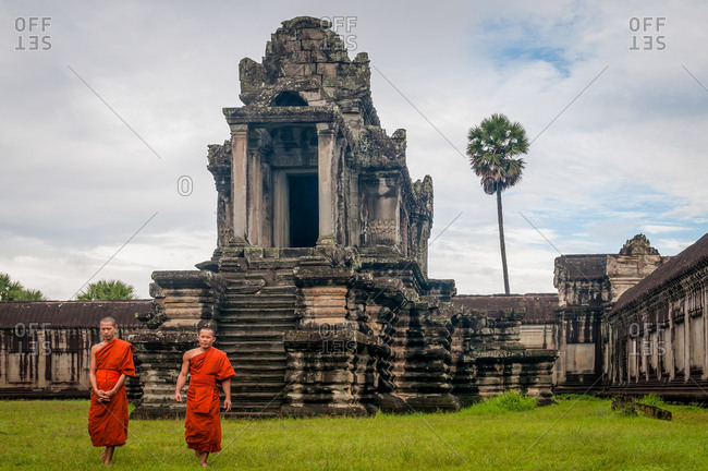 Monk In Angkor Wat, Angkor Park, Siem Reap, Cambodia - 08 October 2011; 2 Monks Walk Away From Library In Inner Courtyard Of Main Temple.