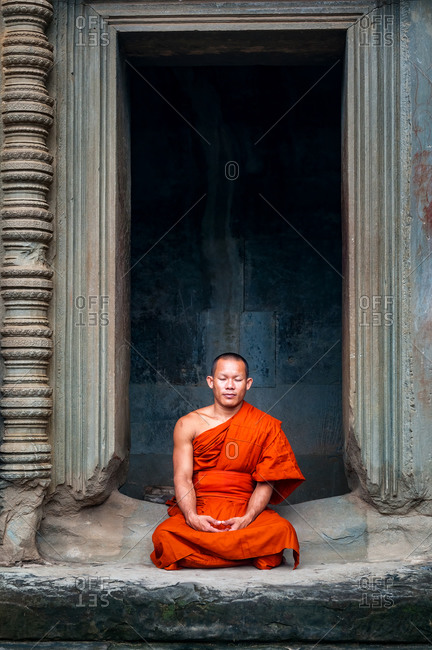 Monk In Angkor Wat, Angkor Park, Siem Reap, Cambodia - 08 October 2011: Lone Monk Meditates In Doorway Of Upper Gallery In Main Temple.