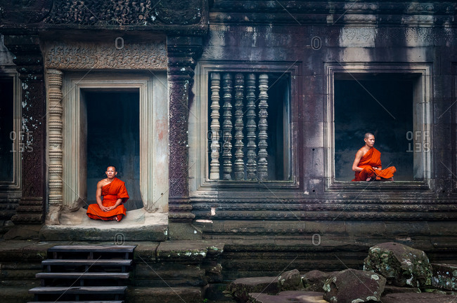 Monk In Angkor Wat, Angkor Park, Siem Reap, Cambodia - 08 October 2011: 2 Monks Meditate In Doorway And Window Of Upper Gallery In Main Temple.