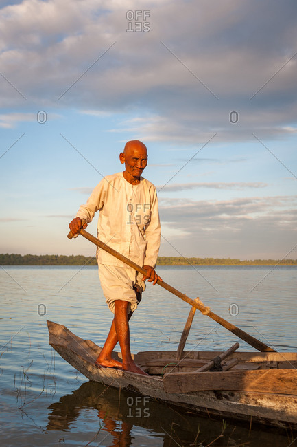 West Baray, Angkor Park, Siem Reap Province, Cambodia - 31 December 2011: Boatman In Khmer Traditional Clothes.