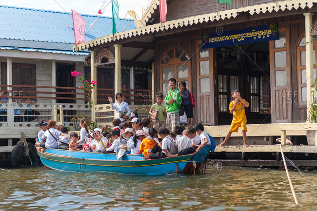 Kompong Luong Floating Village, Krakor District, Cambodia - 10 January 2012: Khmer School Children Leave Classrooms Provided By A Floating Church.