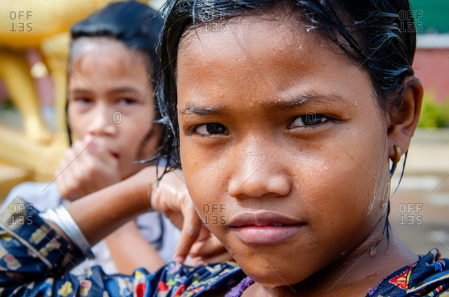 Wat Khleang, Phnom Penh, Cambodia - 28 January 2012: Portrait Of Girls After Washing In Local Temple.