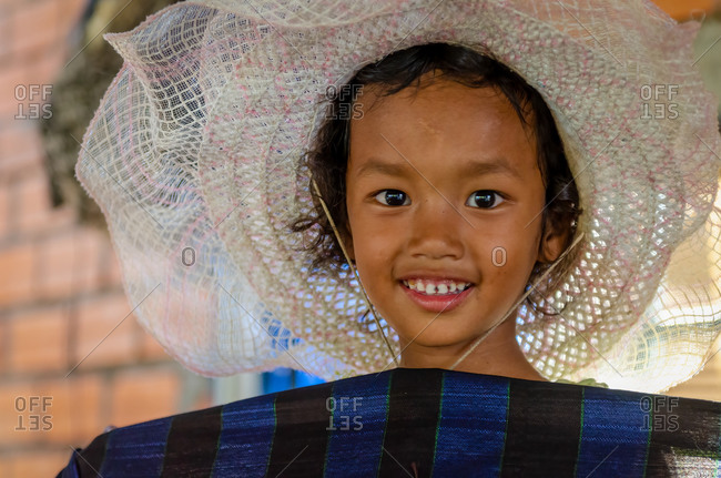 Silk Island (Koh Dach), Cambodia - 28 January 2012: Portrait Of Young Khmer Girl Holding Silk Scarf.