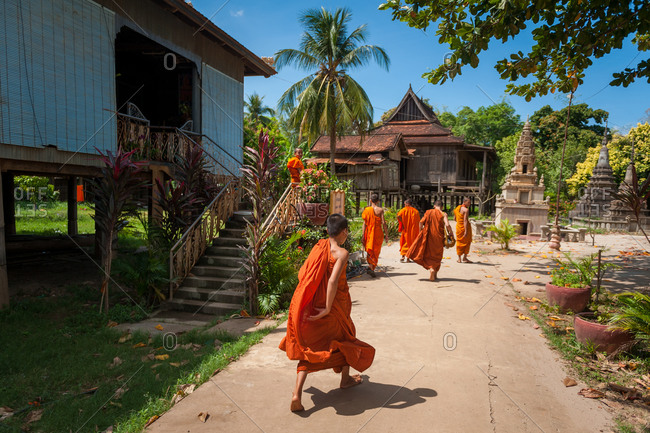 Wat Complex, Kratie Province, Cambodia - 31 January 2012: Monks Make Their Way To Dinning Hall For Lunch.