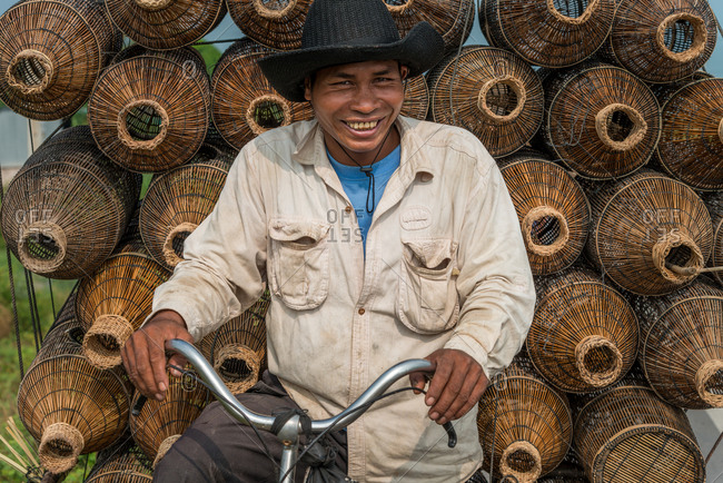 Mobile Salesman, Cambodia - 14 April 2012: Khmer Man Sells Fishing Baskets From Bicycle.