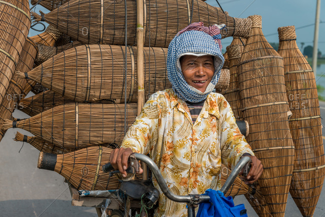 Mobile Saleswoman, Cambodia - 14 April 2012: Khmer Woman Sells Fishing Baskets From Bicycle.