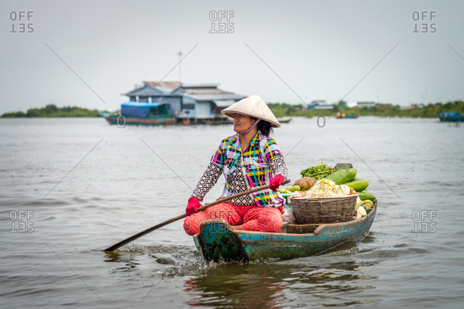 Kompong Luong Floating Village, Krakor District, Cambodia - 15 April 2012: Khmer Lady Uses Her Boat To Sell Fresh Vegetables Between Houses In Typical Lifestyle In Cambodian Floating Village.