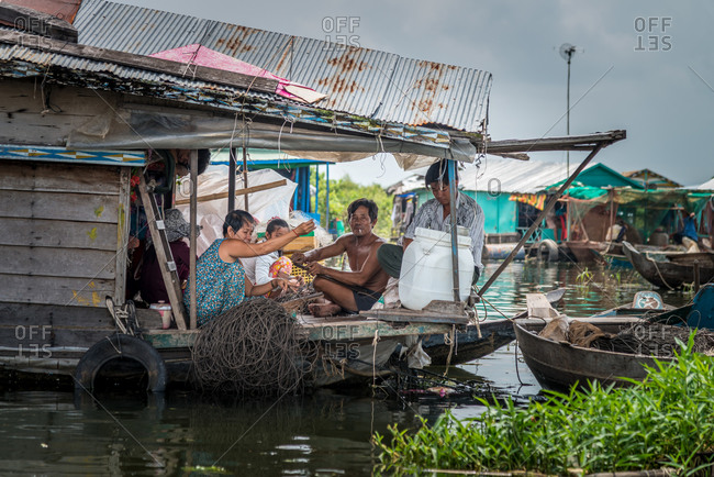 Kompong Luong Floating Village, Krakor District, Cambodia - 15 April 2012: Khmer Family Prepare Twine In Cambodian Floating Village.