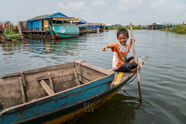 Kompong Luong Floating Village, Krakor District, Cambodia - 15 April 2012: Young Khmer Bow Rows Through Typical Cambodian Floating Village.