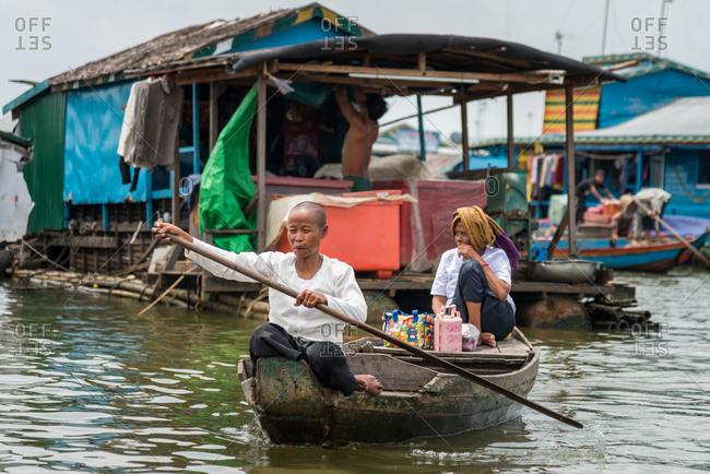 Kompong Luong Floating Village, Krakor District, Cambodia - 15 April 2012: Elder Khmer Women Rows Through Cambodian Floating Village.