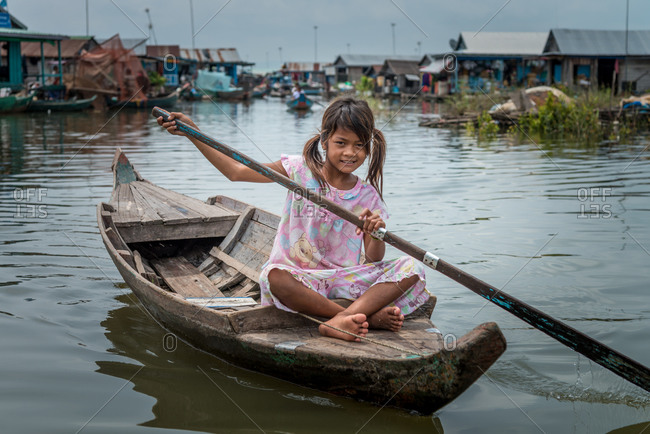 Kompong Luong Floating Village, Krakor District, Cambodia - 15 April 2012: Young Khmer Girl Rows Through Cambodian Floating Village.
