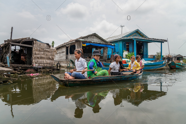 Kompong Luong Floating Village, Krakor District, Cambodia - 15 April 2012:  Khmer Children In Mixed Uniform On Their Way To School In Cambodian Floating Village.