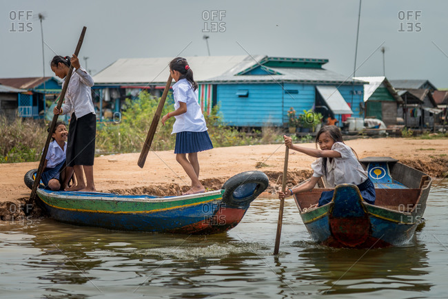 Kompong Luong Floating Village, Krakor District, Cambodia - 15 April 2012:  Khmer Children In Uniform On Their Way To School In Cambodian Floating Village.