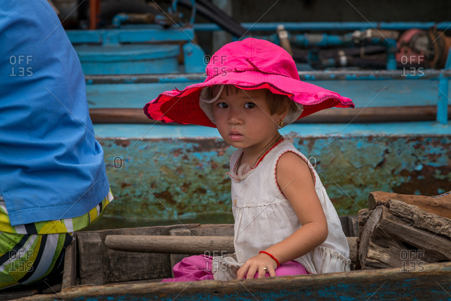 Kompong Luong Floating Village, Krakor District, Cambodia - 15 April 2012: Young Khmer Girl In Her Mothers Boat In Cambodian Floating Village.