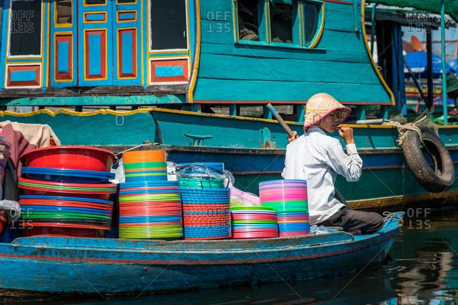 Kompong Luong Floating Village, Krakor District, Cambodia - 24 June 2012: Floating Shop Selling Colorful Washing Up Bowls In Cambodian Floating Village.