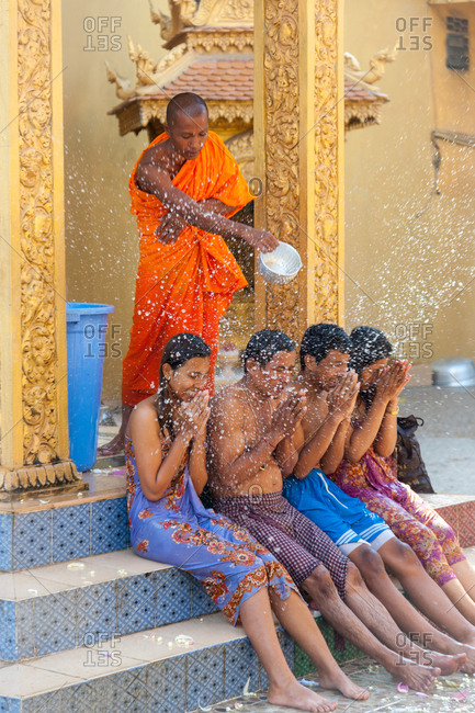 Wat Khleang, Phnom Penh, Cambodia - 26 July 2012: Monk Performs Cleansing Ceremony On Lay People Who Want To Be Blessed.