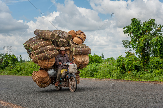Mobile Salesman, On The Road, Cambodia - 21 August 2012: Selling Fishing Baskets From Motorbike.