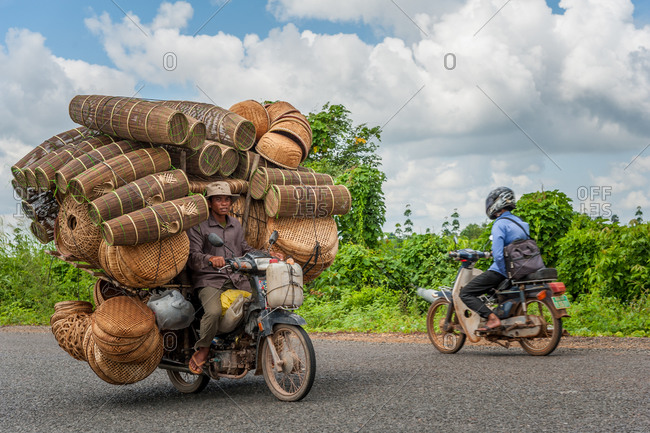 Mobile Salesman On The Road, Cambodia - 21 August 2012: Selling Fishing Baskets From Motorbike.