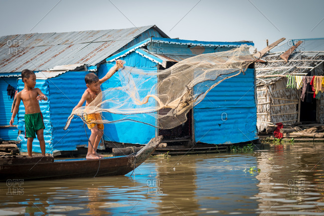 Floating Village, Kompong Chnang, Cambodia - 10 March 2013: Very Young Khmer Boys Practice Throwing Fishing Net.