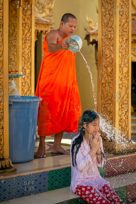 Wat Khleang, Phnom Penh, Cambodia - 05 May 2013: Monk Performs Cleansing Ceremony On Lay People Who Want To Be Blessed.